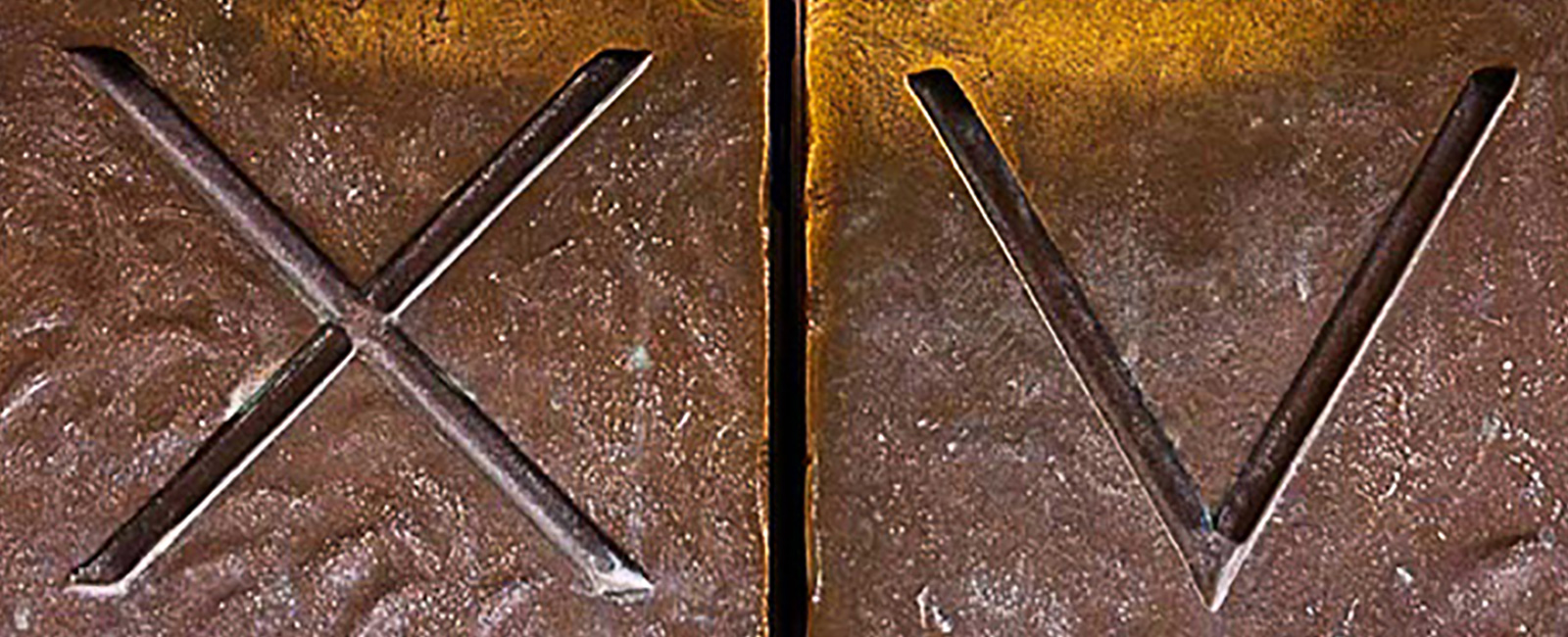 The letter X and the letter V which are our door knobs on the front doors of the hotel