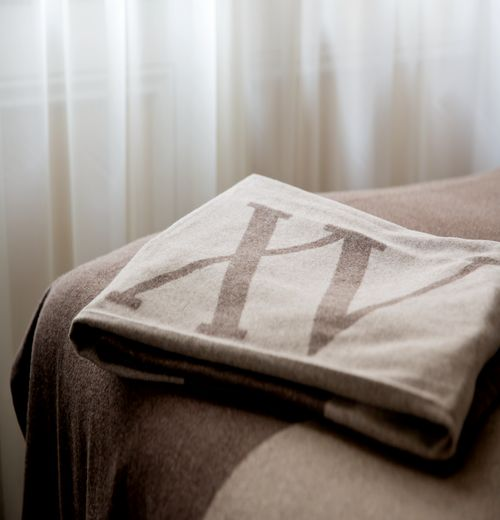 Fifteen Beacon Logo on our cashmere throws that come from Milan.