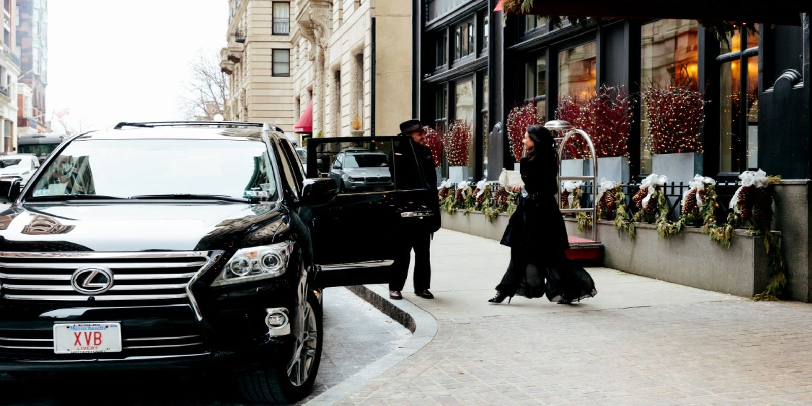 Photograph of a woman in the winter walking into our house Lexus SUV.