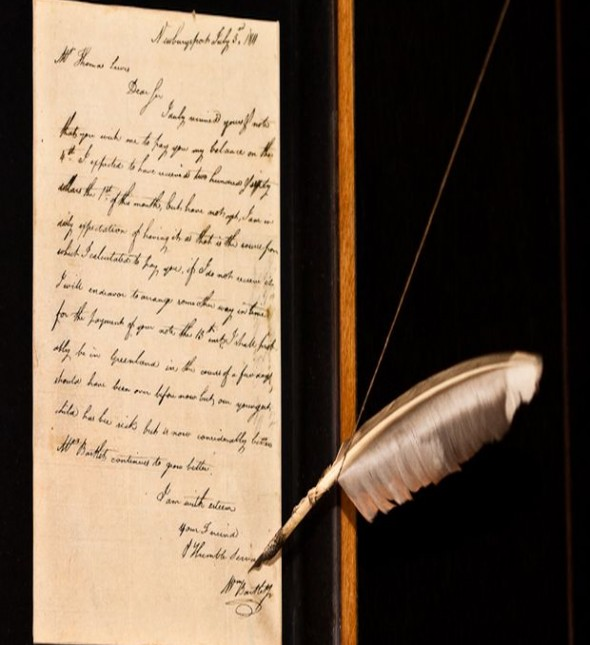 Historic piece of art that is showcased in a letter format with a feather pen