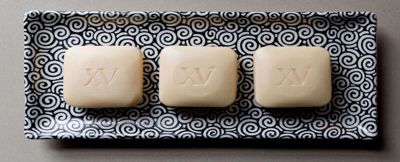 fifteen beacon branded soap bars.