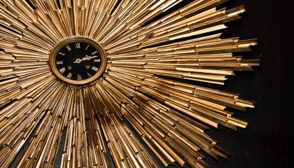 round gold clock that is featured in our hotel lobby.