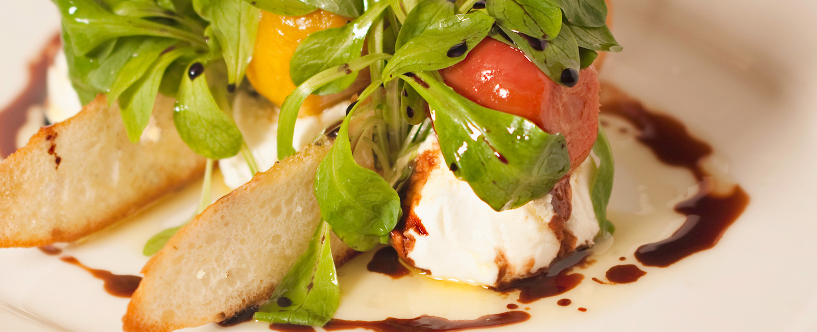 Fresh mozzarella with heirloom tomatoes with balsamic drizzle