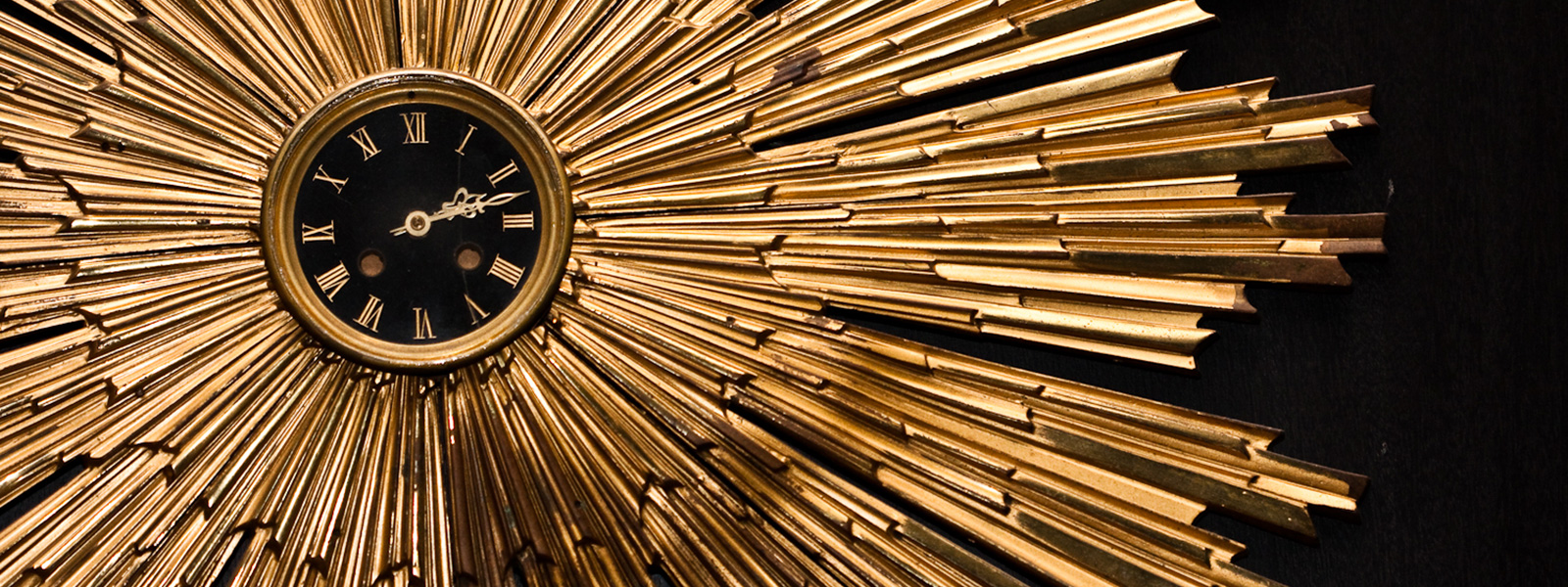 round gold clock that is featured in our hotel.
