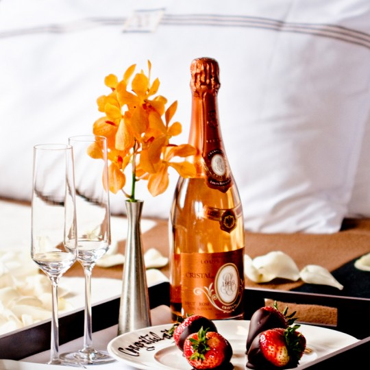 champagne and chocolate covered strawberries sample amenity that can be ordered through room service.