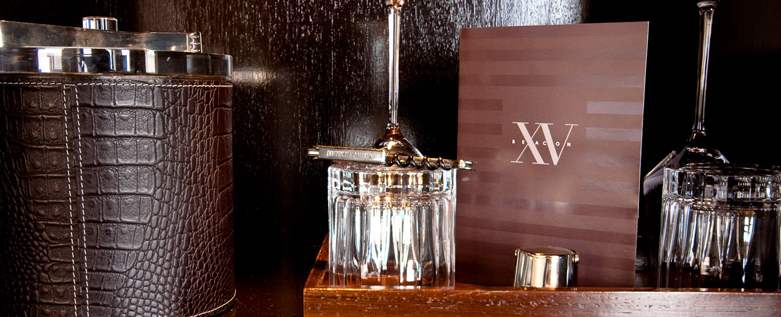photograph of our ice bucket, wine opener, bar menu, and cocktail glasses.
