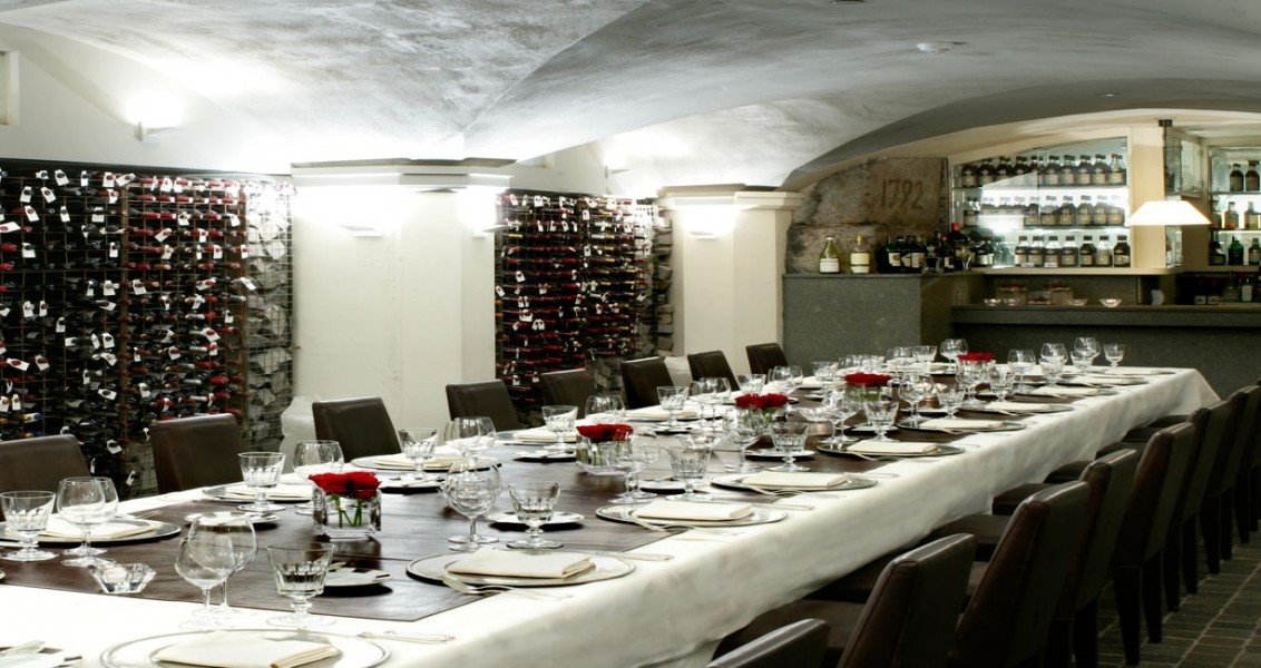 The wine cellar fully set up with one long table to accommodate up to 50 people with rented furniture.