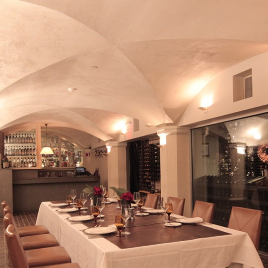 Wine Cellar with our 400 plus wines showcased on the interior of the wine cellars walls. Dinner table in the middle with seating for 8 people.