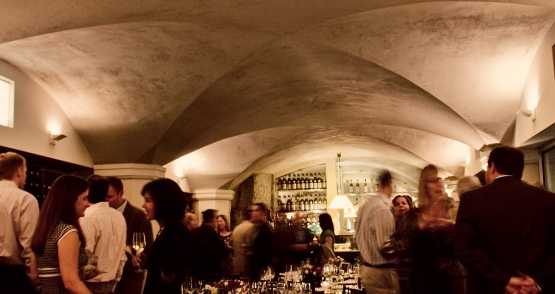 a dozen guests a gathered in our wine cellar for a social event.