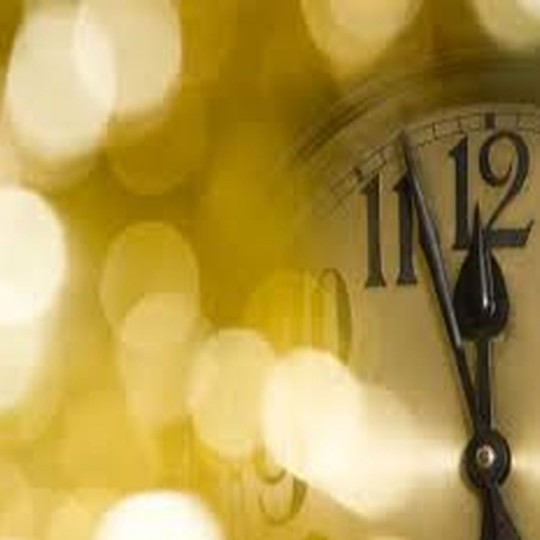 old black and white clock that reads midnight for New Years Eve