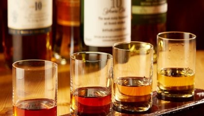 tasting glasses of 4 different kinds of bourbon in our restaurant.