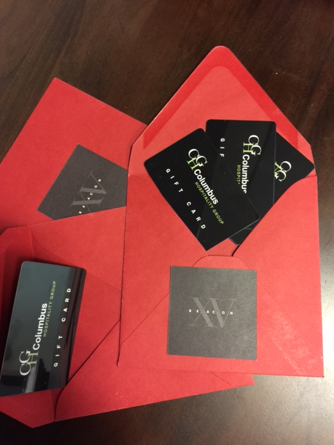 Red Fifteen Beacon envelopes with gift cards from Columbus Hospitality Group