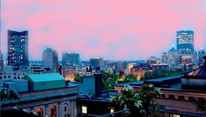 night view from the hotel's roof deck with a pink painted sky for breast cancer awareness month
