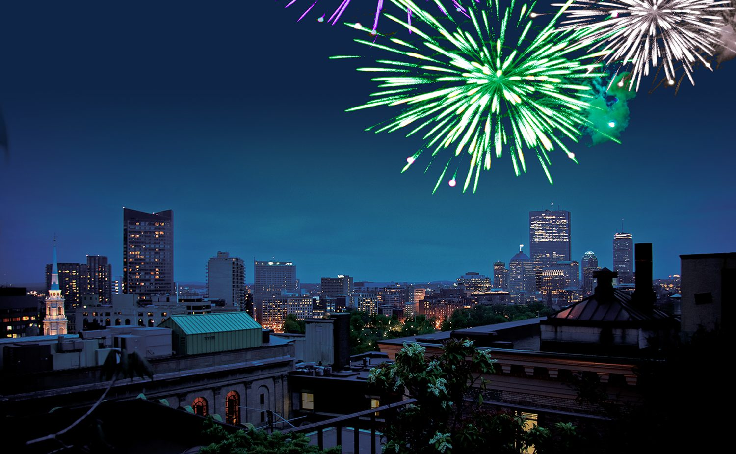 roof deck photo at night with green, gold, and silver fireworks