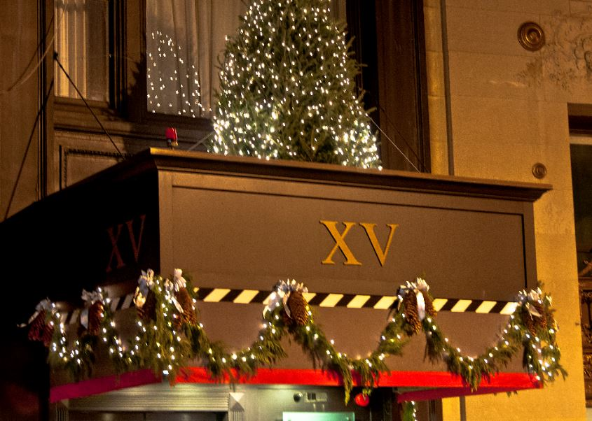 holiday decorations to the exterior of the XV Beacon hotel during christmas