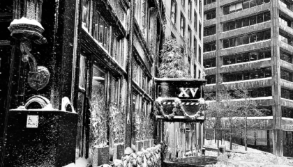 Black and white picture of the exterior of XV Beacon Hotel after a snow fall
