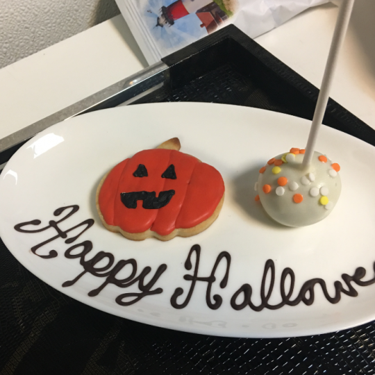 Halloween themed cookie of a pumpkin and a cake pop