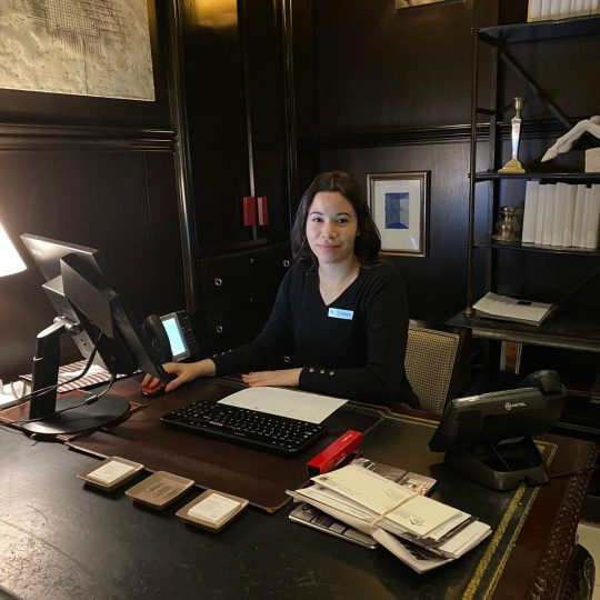 photo of our concierge team member sitting at the concierge desk
