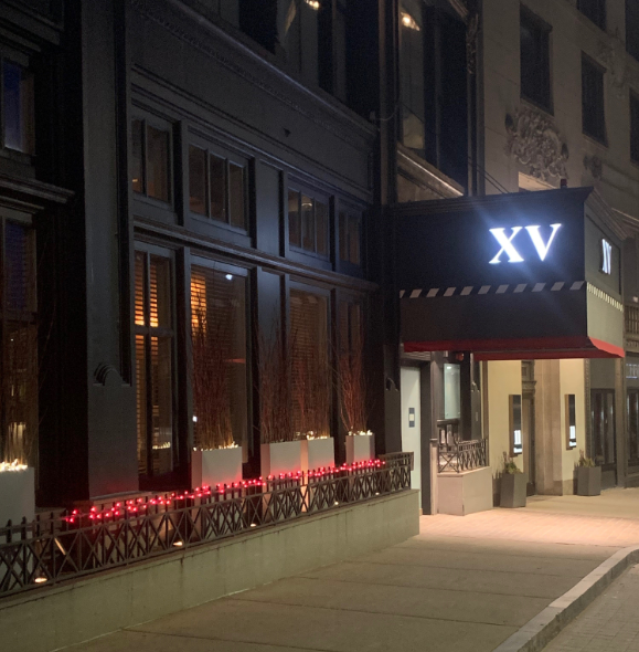 photo of the xv beacon hotel at night with red lights lite