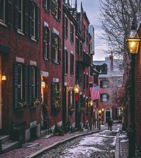 snow covered cobblestone street in Beacon Hill, MA