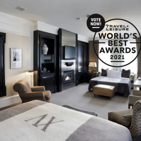 Photo of the Boston Common Studio guestroom within XV Beacon with a Vote Now Logo for the Travel and Leisure World's Best Awards